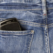 Cellphone and jeans — Stock Photo