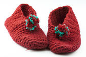 Red knitted slippers — Stock Photo