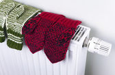 Knitted gloves drying — Stock Photo