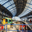Brighton railway station and train in the Spring sunshine. - Stock Photo