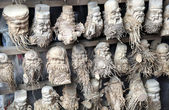 Bamboo Root Carvings of Happy Old Men. — Stock Photo