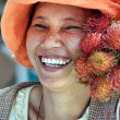 Stock Photo: Smiling Fruit vendor in Hoi Market, Vietnam.