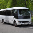 Small White Tour Coach Bus — Stock Photo #22472337