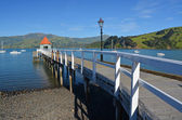 Akaroa Pier and Harbour on Beautiful Summer Day — Stock Photo