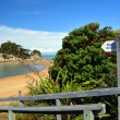 Stock Photo: Beach Access Sign at Kaiteriteri Beach, New Zealand.