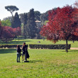 Young Couple Enjoying Spring in The Borghese Gardens, Rome — Stock Photo #41649791