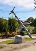 Christchurch Earthquake - Liquefaction Causes Power Poles to Col — Stock Photo