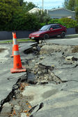Christchurch Earthquake - Car Falls into a Crack in Retreat Road — Stock Photo