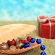 Stock Photo: Christmas ornaments in a sea shell on the beach
