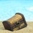 Closed treasure chest on a beach — Stock Photo