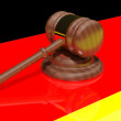 Gavel on the flag of Germany - Stock Photo