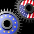 Two gears with the flags of usa and European union - Stock Photo