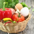 Fresh vegetables in wicker basket — Stock Photo #13922720
