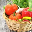 Fresh vegetables in wicker basket — Stock Photo #13922894
