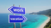 Work or vacation on road signs — Stock Photo