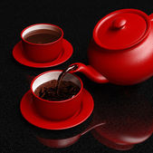 Red coffeepot pouring coffee into cup — Stock Photo