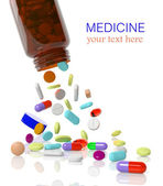 Pills come out from a medicine bottle — Stock Photo