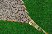 Global Warming. Zipper with cracked earth and grass — Stock Photo