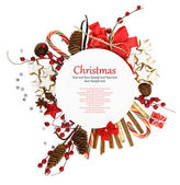 White Christmas plate with ornaments and candies — Stock Photo