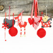 Christmas ornaments hanging on a wooden background — Stock Photo #15845307