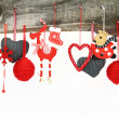 Christmas ornaments hanging on a wooden background — Stock Photo