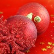 Christmas ornaments on red background — Stock Photo