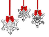 Christmas snowflakes hanging on a bow — Stock Photo