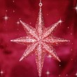Christmas star ornament on bordeaux background — Stock Photo