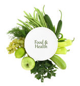 White plate with green food around it — Stock Photo