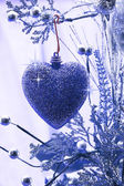 Christmas love. Heart ornament hanging on a branch — Stock Photo