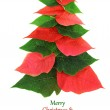 Christmas tree made of poinsettia leaves — Stock Photo