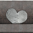 Stock Photo: Heart shape on leather background