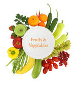 Empty plate with fruits and vegetables around it — Stock Photo
