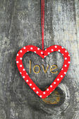 Heart ornament hanging on a tree — Stock Photo