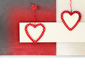 Heart ornament hanging on vintage fabric background — Zdjęcie stockowe