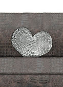 Heart shape on leather background — Stok fotoğraf