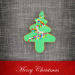 Christmas card with tree cookie on fabric background — Stock Photo