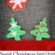Christmas card with cookies on fabric background — Stock Photo