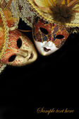 Vintage carnival masks on black background with copy-space — Stock Photo