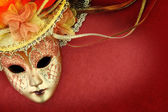 Vintage carnival mask on red background — Stock Photo