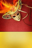 Vintage carnival mask on yellow background — Stock Photo
