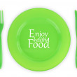 Green plate with fork and knife isolated on white — Stock Photo
