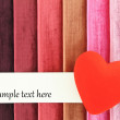Red heart on color background - Foto Stock