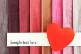 Red heart on color background — Stock Photo