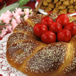 Easter sweet bread with red eggs — Stock Photo