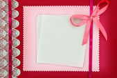 Empty card on pink fabric texture — Stock Photo