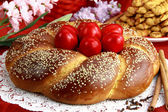 Easter sweet bread with red eggs — Zdjęcie stockowe