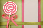 Blank banner with lollipop on green background — Stock Photo