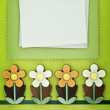 Chocolate flowers and paper greeting card — Stock Photo