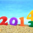 Multicolored new year 2014 on the beach — Stock Photo #22267315